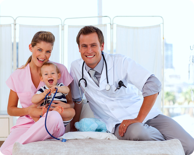 nurse, caregiver and baby on bed